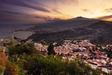 taormina: Aerial view of Mount etna at sunset from Taormina Stock Photo