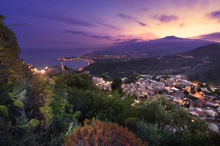 taormina: Sicily: Aerial view of Etna Mount and Taormina at sunset