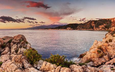 taormina: Mount Etna at sunrise seen from Taormina, Sicily Stock Photo