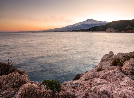 SEA  LANDSCAPE: Sicily, Italy: Mount Etna seen from Taormina at sunset Stock Photo