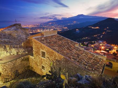 taormina: Taormina, Sicily: beautiful Etna at dusk Stock Photo