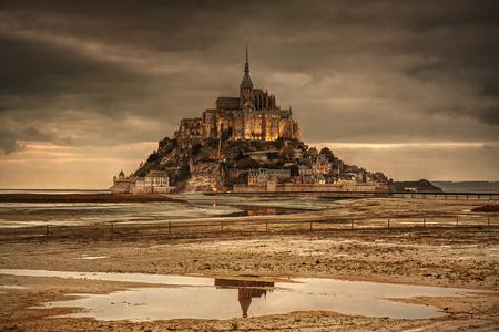 Normandy, France: beautiful Mont Saint-Michel island at sunset. Redakční