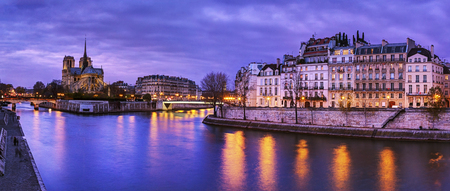 the river: Paris, France: Notre Dame at dusk with Seine river on foreground