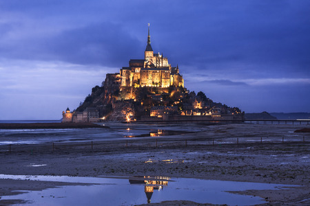 michel: Beautiful Mont Saint Michel in France seen at dusk Editorial