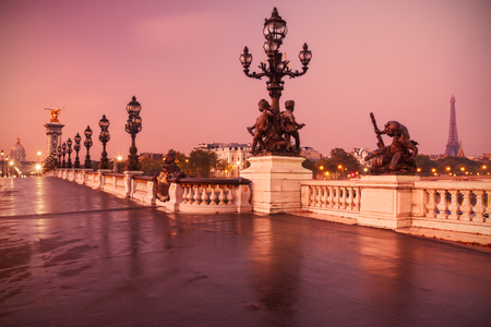 alexandre: Paris, France: Alexandre III Bridge at sunrise with Eiffel Tower (on right) and H�tel des Invalides (on left). Stock Photo