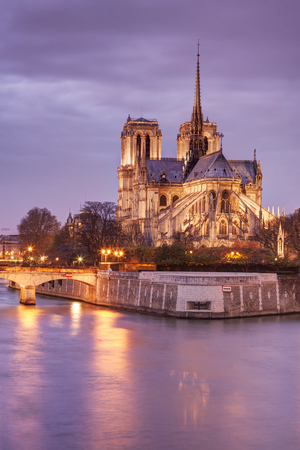 le: Notre Dame cathedral in Paris, France, at dusk.
