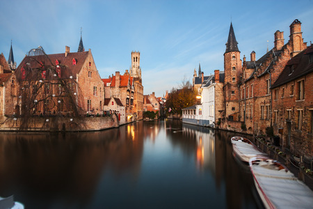 bruges: Beautiful canal and famous Belfry in Bruges (Brugge), Flanders, Belgium. Editorial