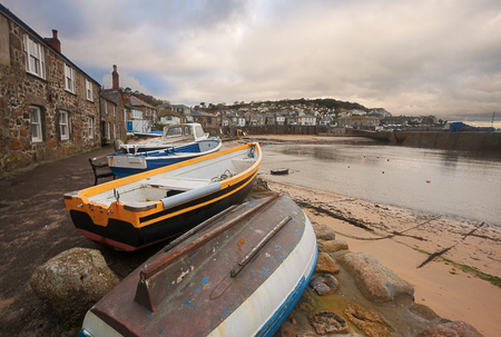 mousehole: Mousehole: a small picturesque village near Penzance (Cornwall, England). Fishing boats on foreground.