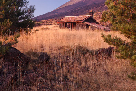mountain hut: Beautiful mountain hut in Sicily, Italy; Etna volcano on background. Stock Photo