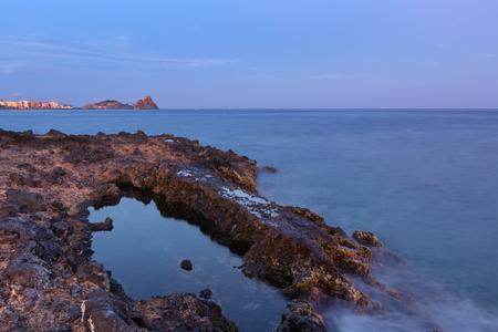 Aci trezza (Sicily - Italy): Cyclopean Isles (or Faraglioni) and village. Stock Photo