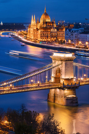 Chain Bridge and hungarian Parliament in Budapest at twilight.