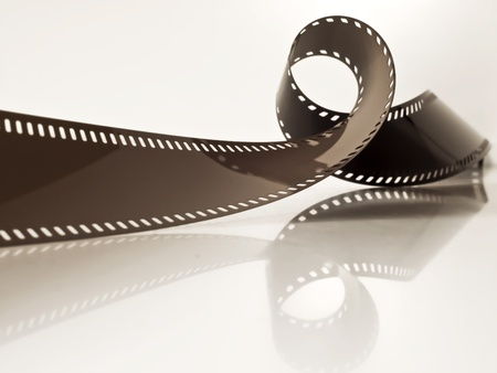 slightly rolled undeveloped film strip on a glossy surface Stock Photo - 9239996