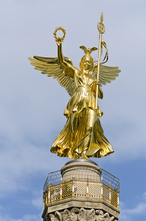 winning location: golden statue on top of the victory column in Berlin, Germany Stock Photo