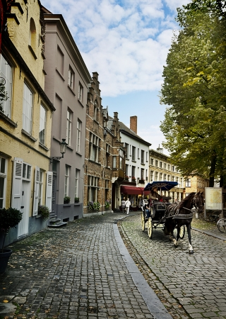 horse and carriage: Horse carriage going through the old town of Bruges, Belgium