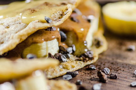 unhealthful: Closeup of banana and choco chips pancake with syrup on it Stock Photo
