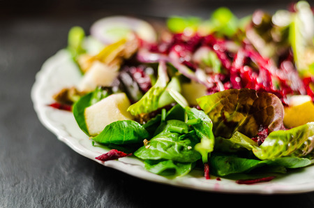 healthful: Closeup of healthy salad in plate on table