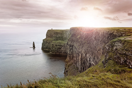 scenic sunset over the Cliffs of Moher, Co. Munster, Ireland photo