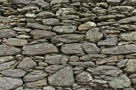 stone wall consisting of loose rocks suitable as background texture Stock Photo