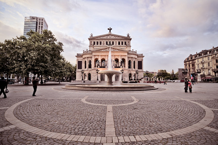 frontal view of the old opera building at dawn in Frankfurt, Germany