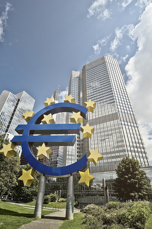 eurozone: Euro Sign in front of the European Central Bank (ECB) headquarter building in Frankfurt am Main, Germany Editorial