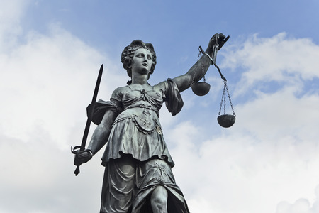 roemerberg: Statue of Justice with sword and scales in front of a blue cloudy sky
