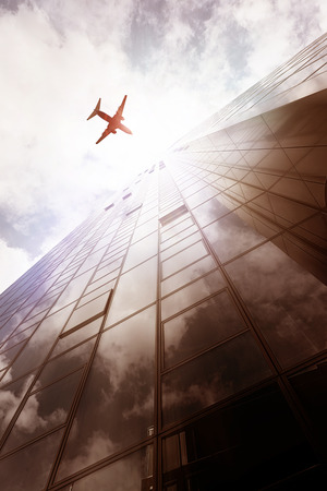 plane flying over an office building in Frankfurt am Main, Germany photo