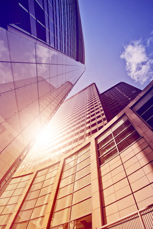 modern glass and steel office tower in the sun, Frankfurt am Main, Germany Stock Photo