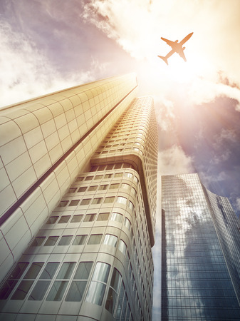 plane flying over office skyscrapers in Frankfurt am Main, Germany photo