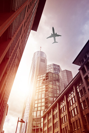 plane flying over office district of Frankfurt am Main, Germany photo
