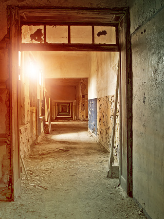 industrial ruins: hallway in an abandoned industrial complex