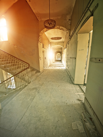 hallway in an abandoned hospital in the evening sun photo