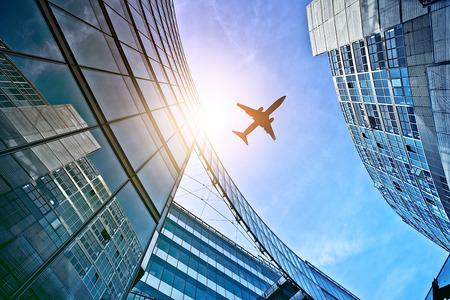 plane flying over modern glass and steel office buildings near Potsdamer Platz, Berlin, Germany Standard-Bild