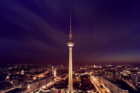 east berlin: aerial photograph of the TV Tower (Fernsehturm) at night in Berlin, Germany