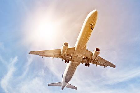 departing plane in the sun seen from below Reklamní fotografie