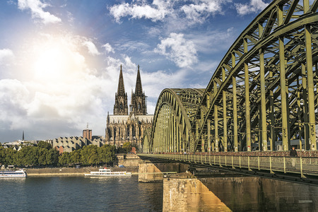 dom: View of the Cologne Cathedral and Hohenzollern Bridge across the rhine river, Cologne, Germany