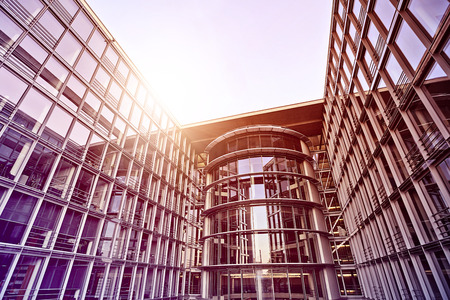 modern glass and steel office building in the sun, Berlin, Germany Archivio Fotografico