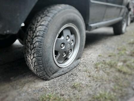 flat tire: Photo of a flat tire