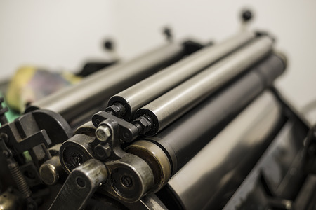 printing inks: steel cylinders of an old press in a printing shop Stock Photo