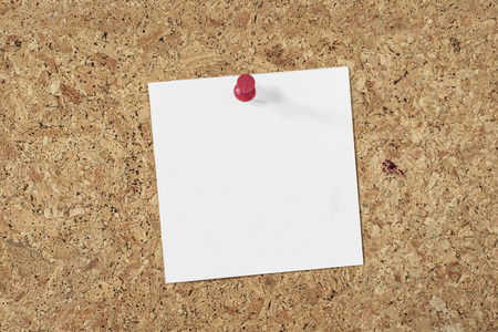 blank note: blank paper note pinned on a cork background Stock Photo
