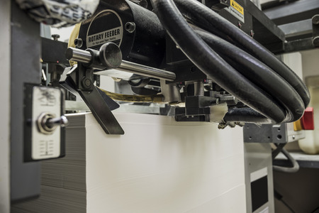 offset view: detailed view of a sheetfed offset printing machine filled with blank paper Stock Photo