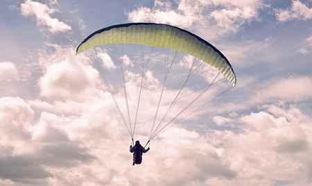 paraglider: paraglider flying through a cloud formation