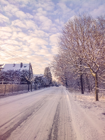 christmas winter: Scenic street in a village after the snowfall