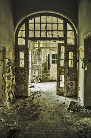factory: hallway with destroyed doors in an abandoned hospital complex Stock Photo
