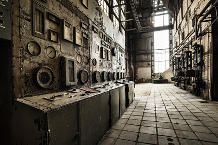 rusty control unit in an old abandoned factory building