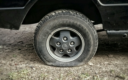 Flat tire on a car Stock Photo