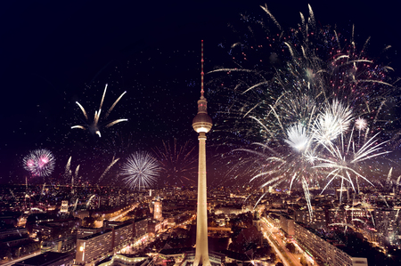 aerial photograph of the TV Tower (Fernsehturm) with fireworks at night in Berlin, Germany
