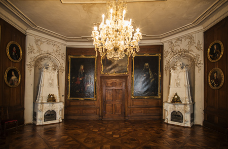 GOTHA, GERMANY - APRIL 15, 2015: room with pictures of the late rulers hanging of late baroque style Friedenstein Castle in Gotha, Germany