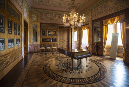 liszt: WEIMAR, GERMANY - APRIL 17, 2014: Famous Ceder room with a piano in the Stadtschloss (city castle) of Weimar, Thuringia, Germany Editorial