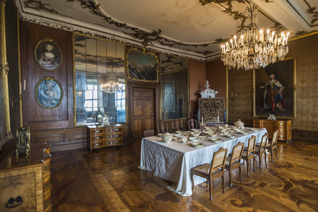 table set: GOTHA, GERMANY - APRIL 15, 2015: dining room with richly set table of late baroque style Friedenstein Castle in Gotha, now used as a museum, Germany