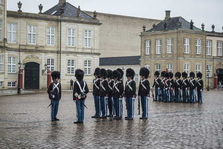 gatehouse: COPENHAGEN, DENMARK - JANUARY 2, 2014: unidentified soldiers of the Royal Guard in Amalienborg Castle by changing the guards on January 2, 2014 in Copenhagen, Denmark